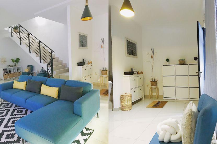 Gabungan perabot putih di ruang masuk dan sofa rona biru laut memberi karakter tersendiri pada hiasan dalaman