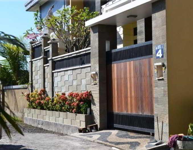 Desain Pagar Rumah Cantik Kombinasi Kayu Besi dan Batu Alam