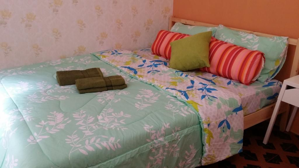Katil atau katil katil dalam bilik di Homestay 17 cherating damai