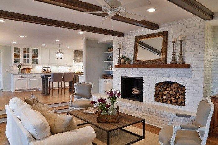 Contoh foto yang bagus dari desain semacam itu bisa menjadi ruang tamu ber a loteng di manadinding putih batu bata di pedalaman Dengan rak buku