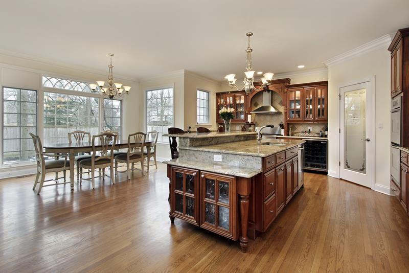 VIEW IN GALLERY Konsep elegant menjadi pilihan dalam hiasan dalaman ruang tamu dan dapur terbuka ini